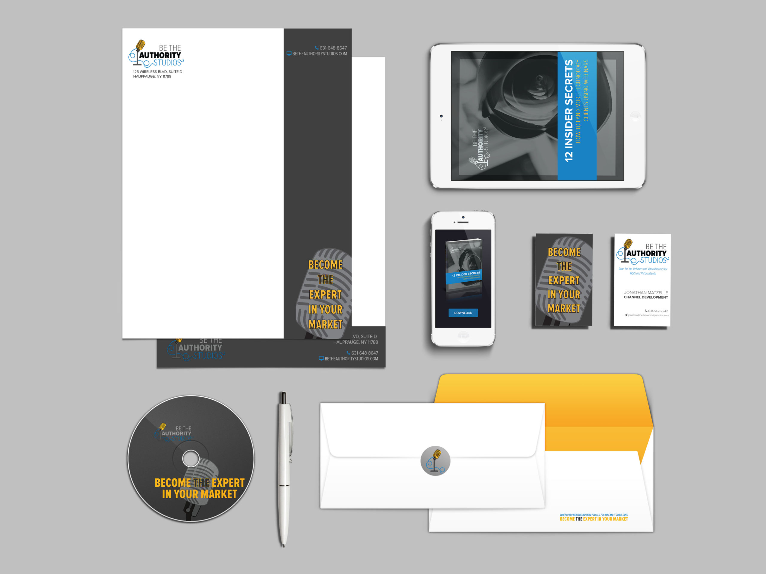 Flat lay including letterhead, envelope, iPad, CD, phone and business cards, all branded with Be The Authority logo.